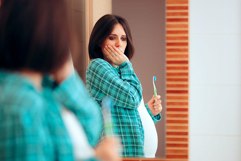 ê buốt chân răng khi mang thai