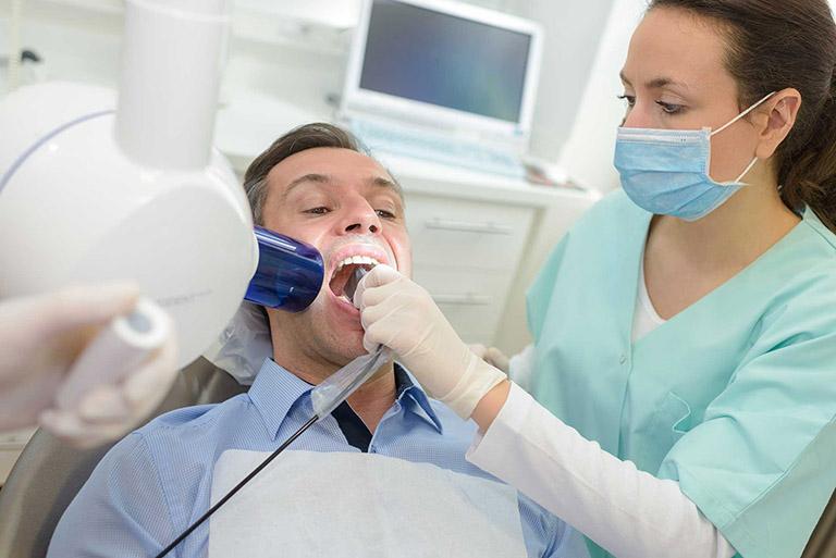 đau răng sau khi làm răng sứ